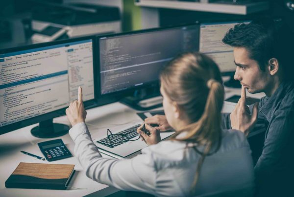 Business people developing programming and coding technologies